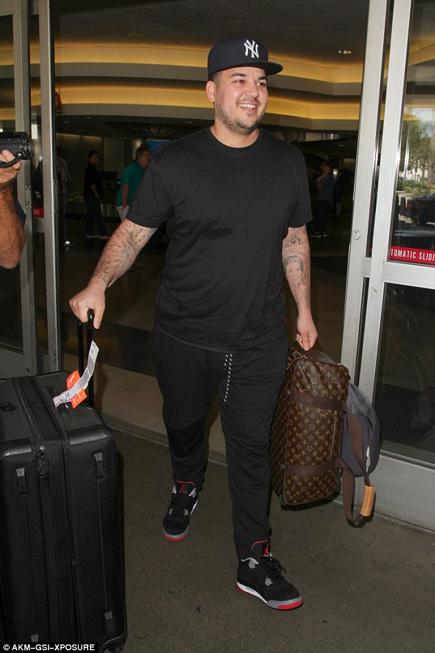 Rob Kardashian calls Blac Chyna his wife on social media hours after giving her a purple Lamborghini(video)