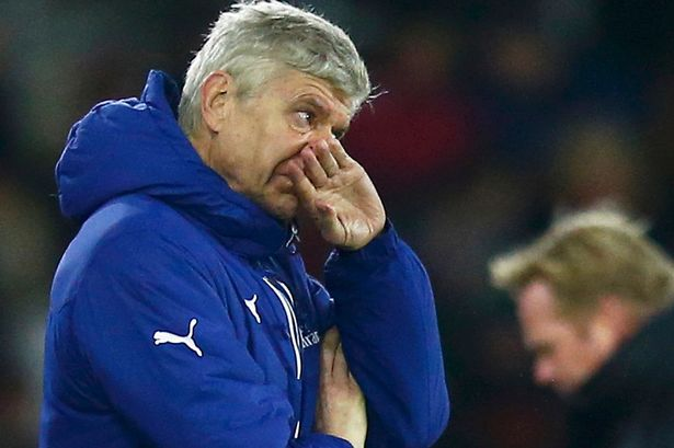 Arsene Wenger insists he is NOT happy with a top 4finish
